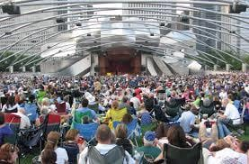 people sitting at a concert at pritzker pavilion in millennium park Chicago